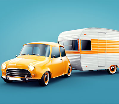 Beginner's guide to caravan holidays – a Mini car towing a retro caravan