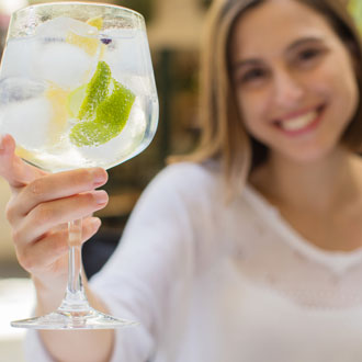 Woman with a gin and tonic