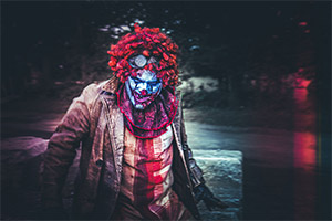 Killer clown with blood stained clothes