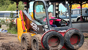 Little girl on digger at Diggerland
