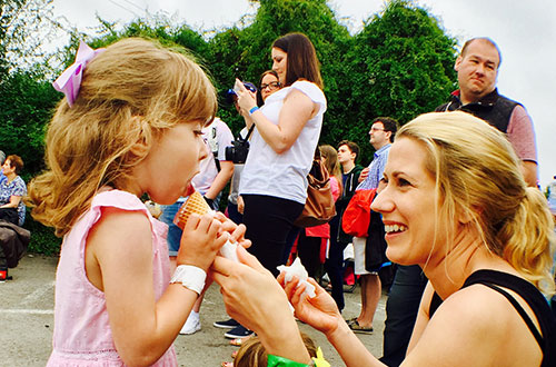 A girl and mum try food at Cowbridge Food Festival